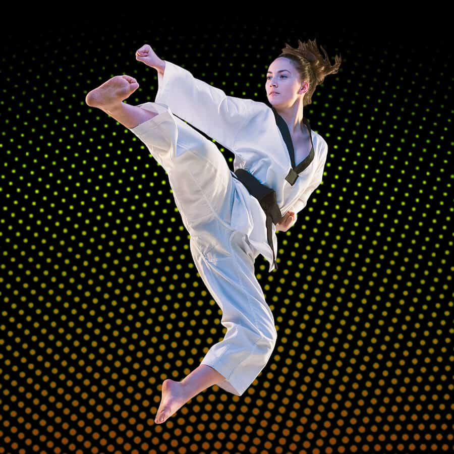 Martial Arts Lessons for Adults in San Antonio TX - Girl Black Belt Jumping High Kick