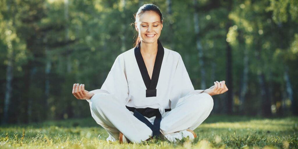Martial Arts Lessons for Adults in San Antonio TX - Happy Woman Meditated Sitting Background