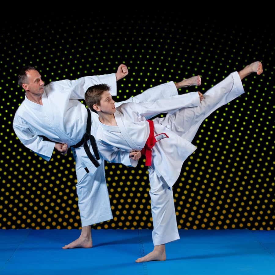 Martial Arts Lessons for Families in San Antonio TX - Dad and Son High Kick